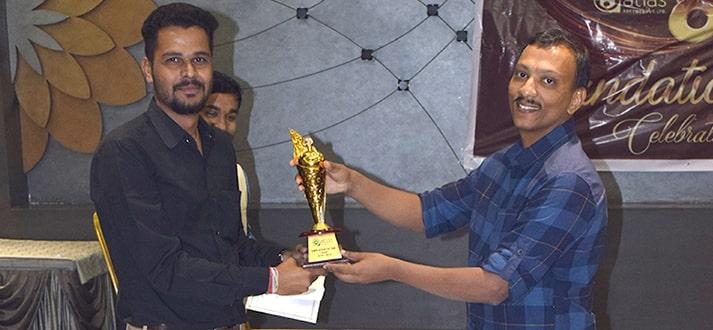 Senior Graphic Designer Rakesh Sathwara is receving an award